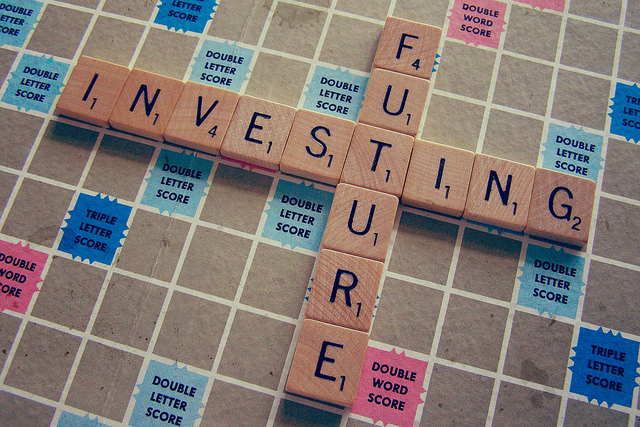scrabble tiles spelling out investing and future